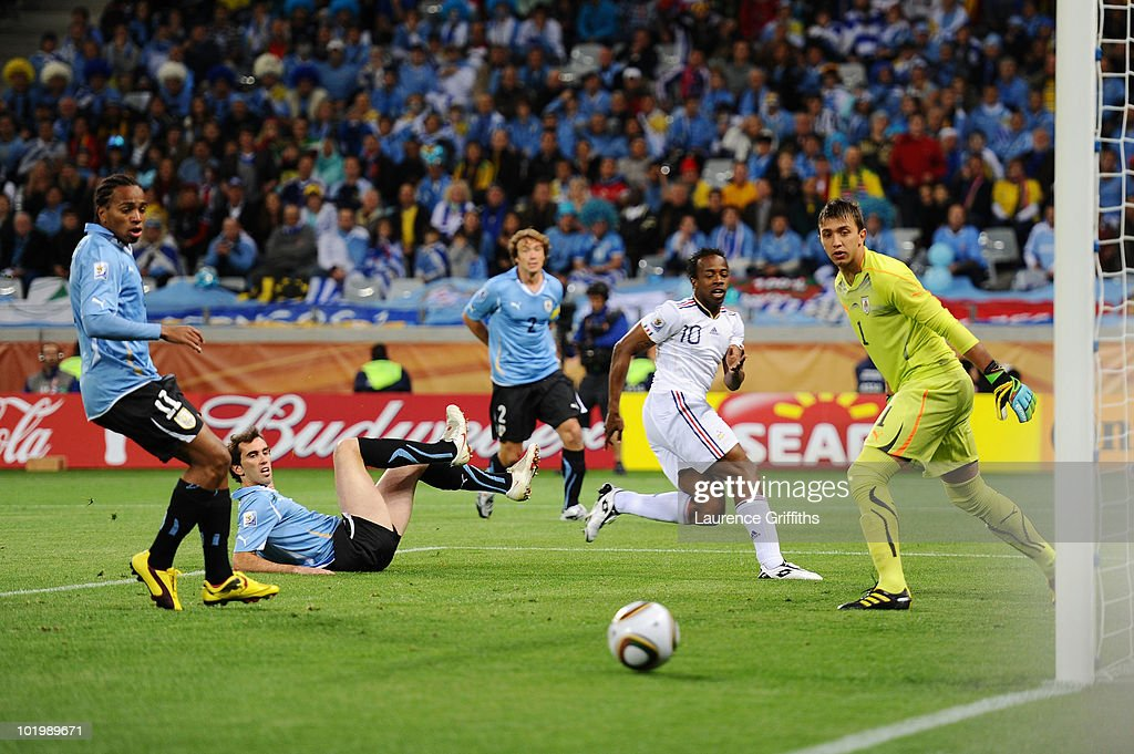 Fernando Muslera of Uruguay watches a shot by Sidney Govou of France go wide of the post during the 2010 FIFA World Cup South Africa Group A match between Uruguay and France at Green Point Stadium on June 11, 2010 in Cape Town, South Africa.