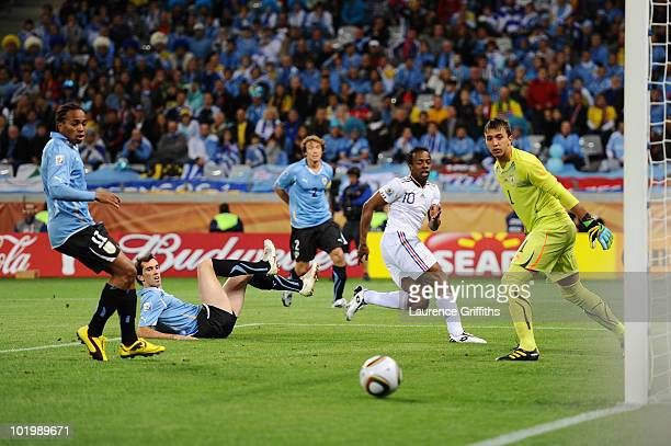 Fernando Muslera of Uruguay watches a shot by Sidney Govou of France go wide of the post during the 2010 FIFA World Cup South Africa Group A match...