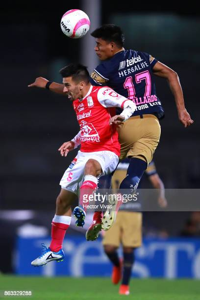 Fernando Navarro of Leon struggles for the ball with Jesus Gallardo of Pumas during the 10th round match between Pumas UNAM and Leon as part of the...