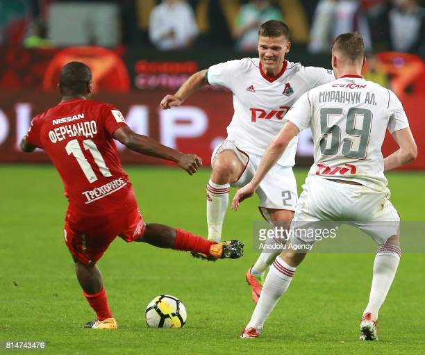 Fernando of FC Spartak Moscow and Igor Denisov of FC Lokomotiv Moscow in action during Russian Super Cup match between FC Lokomotiv Moscow vs FC...