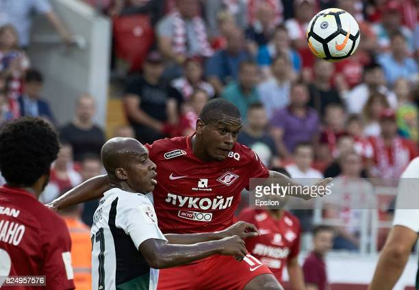 Fernando of FC Spartak Moscow vies for the ball with Charles Kabore of FC Krasnodar during the Russian Premier League match between FC Spartak Moscow...