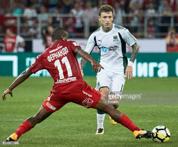 Fernando of FC Spartak Moscow vies for the ball with Pavel Mamayev of FC Krasnodar during the Russian Premier League match between FC Spartak Moscow...