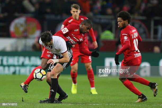 Fernando of FC Spartak Moscow vies for the ball with Saeid Ezatolahi of FC Amkar Perm during the Russian Premier League match between FC Spartak...