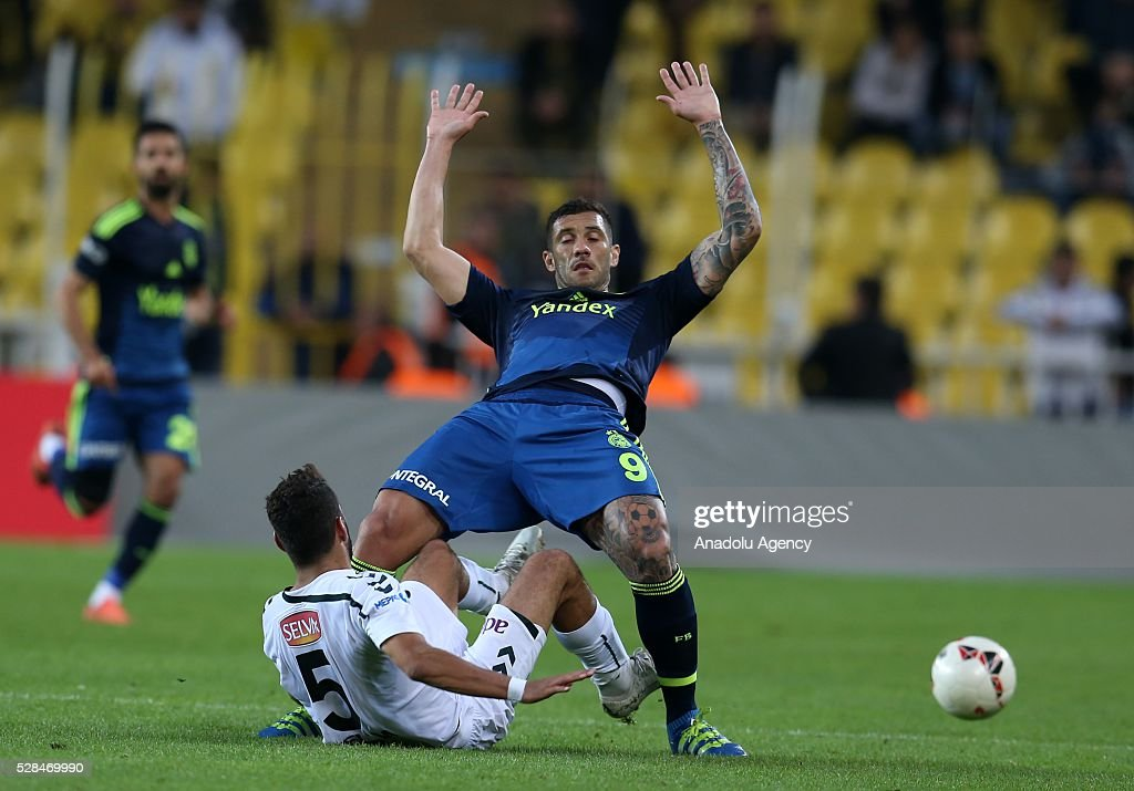 Fernando of Fenerbahce and Selim Ay of Torku Konyaspor vie for the ball during the during Ziraat Turkish Cup Semi Final second leg football match between Fenerbahce and Torku Konyaspor at Ulker Stadium in Istanbul, Turkey on May 5, 2016.
