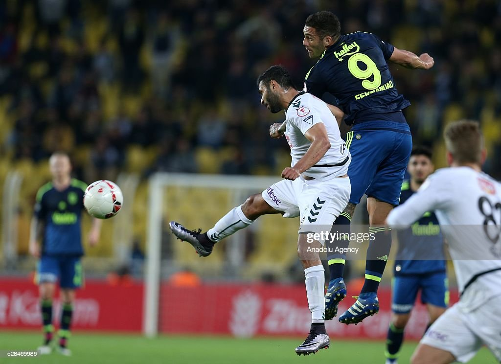 Fernando (R) of Fenerbahce and Volkan Findikli of Torku Konyaspor vie for the ball during the during Ziraat Turkish Cup Semi Final second leg football match between Fenerbahce and Torku Konyaspor at Ulker Stadium in Istanbul, Turkey on May 5, 2016.