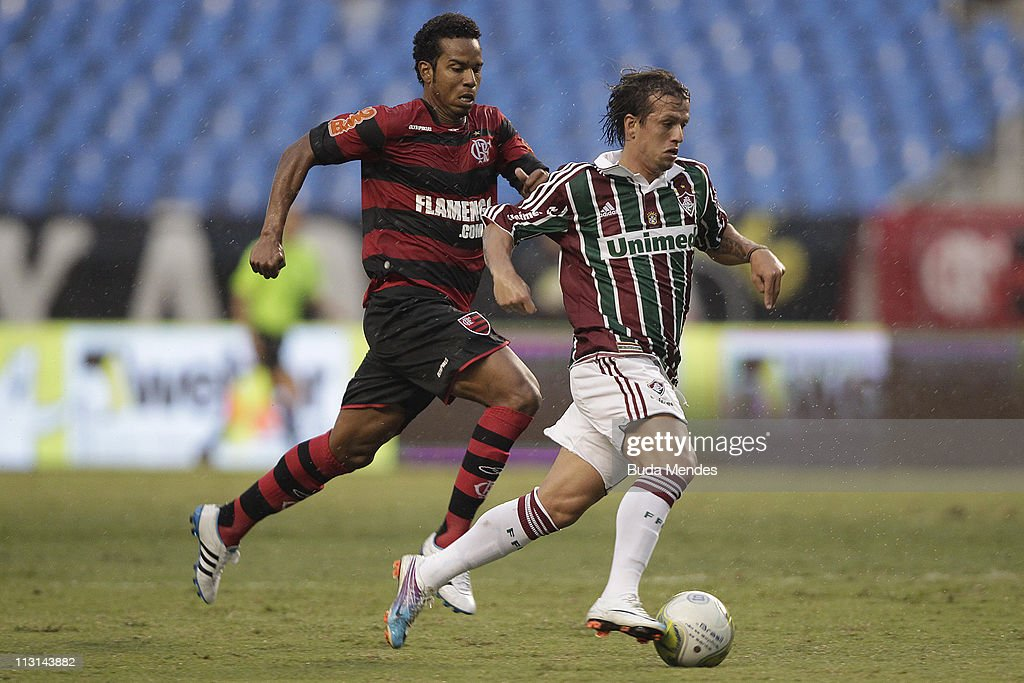 Fernando of Flamengo struggles for the ball with Diguinho of Fluminense during a match as part Semifinal of Rio de Janeiro State Championship 2011 at...