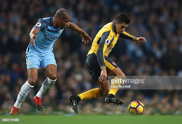 Fernando of Manchester City and Alexis Sanchez of Arsenal battle for possession during the Premier League match between Manchester City and Arsenal...