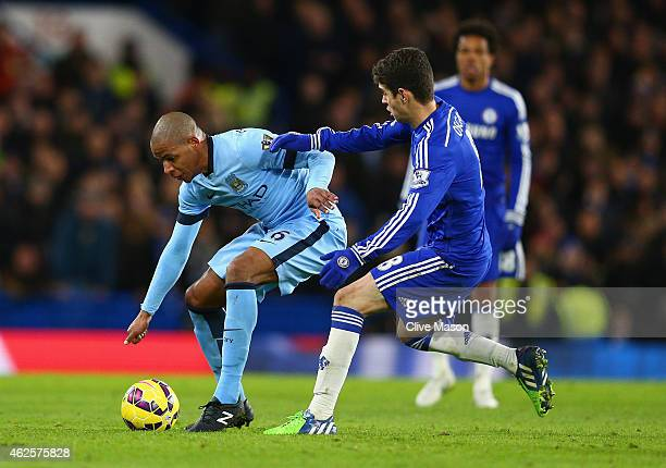 Fernando of Manchester City and Oscar of Chelsea battle for the ball during the Barclays Premier League match between Chelsea and Manchester City at...