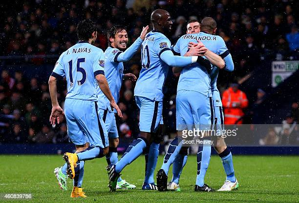 Fernando of Manchester City celebrates with teammates after scoring the opening goal during the Barclays Premier League match between West Bromwich...