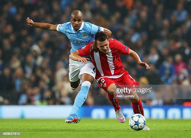 Fernando of Manchester City challenges Yevhen Konoplyanka of Sevilla during the UEFA Champions League Group D match between Manchester City and...