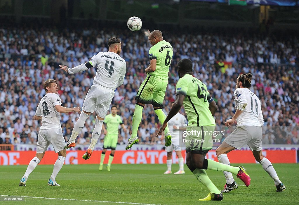 Fernando of Manchester City heads the ball past <a gi-track='captionPersonalityLinkClicked' href=/galleries/search?phrase=Sergio+Ramos+-+Jugador+de+f%C3%BAtbol&family=editorial&specificpeople=491009 ng-click='$event.stopPropagation()'>Sergio Ramos</a> of Real Madrid during the UEFA Champions League Semi Final second leg match between Real Madrid and Manchester City FC at Estadio Santiago Bernabeu on May 4, 2016 in Madrid, Spain.