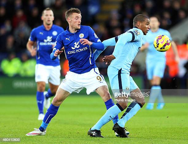 Fernando of Manchester City holds off Jamie Vardy of Leicester City during the Barclays Premier League match between Leicester City and Manchester...