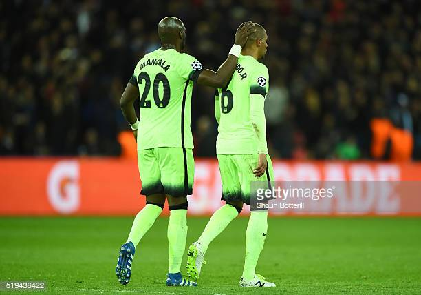 Fernando of Manchester City is consoled by team mate Eliaquim Mangala his dejection after his pass hitting Zlatan Ibrahimovic of Paris SaintGermain...