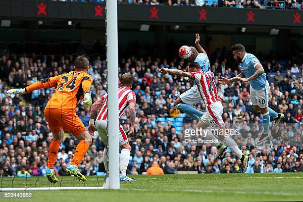 Fernando of Manchester City scores the opening goal past Shay Given of Stoke City during the Barclays Premier League match between Manchester City...