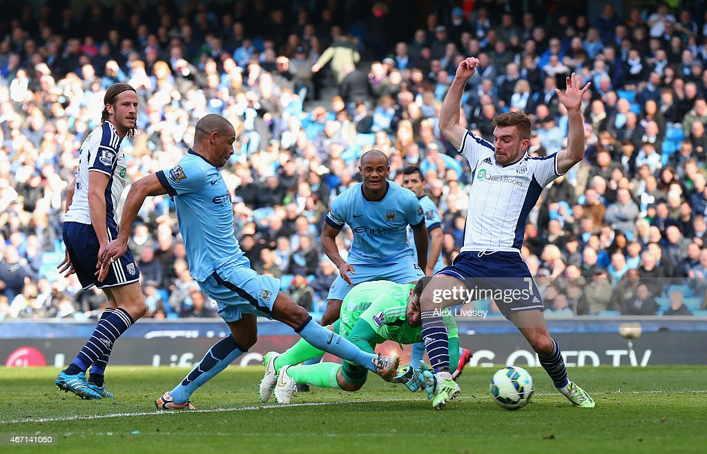 Fernando of Manchester City scores their second goal under pressure from James Morrison and Boaz Myhill of West Brom during the Barclays Premier League match between Manchester City and West Bromwich Albion at Etihad Stadium on March 21, 2015 in Manchester, England.