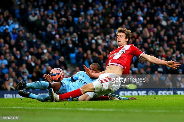 Fernando of Manchester City slides in and attempts to clear the ball but it rebounds off Patrick Bamford of Middlesbrough and crosses the goal line...