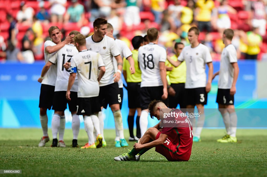 Fernando of Portugal reacts as team Germany celbrates their 40 wn over Portugal during the second half of the Men's Football Quarterfinal match on...