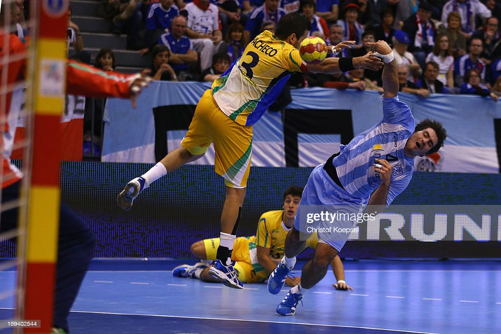 Fernando Pacheco of Brazil defends against Sebastian Simonet of Argentina during the premilary group A match between Brasil and Argentina and Montenegro at Palacio de Deportes de Granollers on January 13, 2013 in Granollers, Spain.
