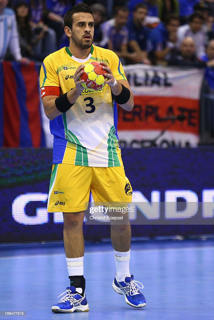 Fernando Pacheco of Brazil passes the ball during the premilary group A match between Brasil and Argentina and Montenegro at Palacio de Deportes de Granollers on January 13, 2013 in Granollers, Spain.