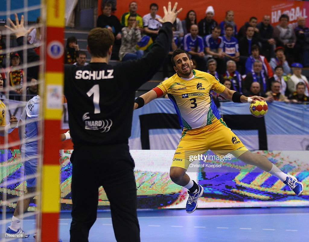 Fernando Pacheco of Brazil (R) scores a goal against Matias Schulz of Argentina (L) during the premilary group A match between Brasil and Argentina and Montenegro at Palacio de Deportes de Granollers on January 13, 2013 in Granollers, Spain.