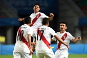Fernando Pacheco#17 of Peru celebrates with his teammates after scoring against Cape Verde during the 2014 FIFA Boys Summer Youth Olympic Football...