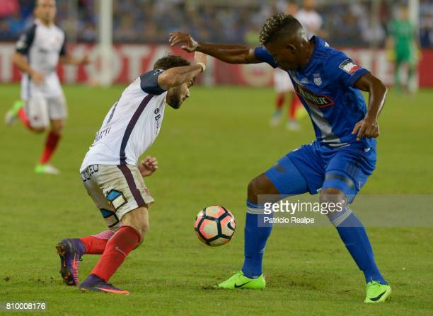 Fernando Pinillo of Emelec figths for the ball with Franco Mussis of San Lorenzo during a first leg match between Emelec and San Lorenzo as part of...