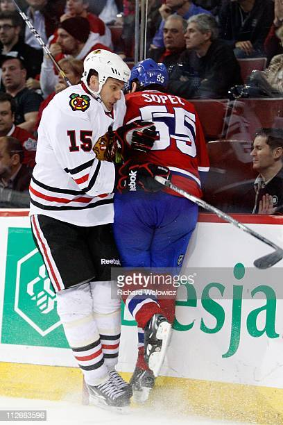 Fernando Pisani of the Chicago Blackhawks body checks Hal Gill of the Montreal Canadiens during the NHL game at the Bell Centre on April 5 2011 in...