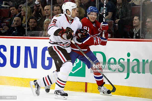 Fernando Pisani of the Chicago Blackhawks body checks Lars Eller of the Montreal Canadiens during the NHL game at the Bell Centre on April 5 2011 in...
