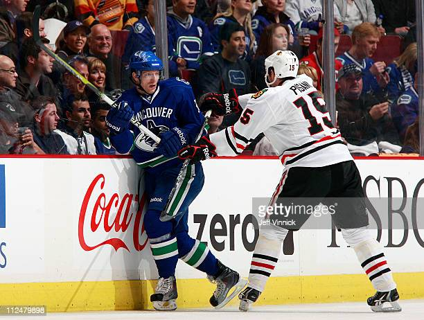 Fernando Pisani of the Chicago Blackhawks checks Jannik Hansen of the Vancouver Canucks in Game Two of the Western Conference Quarterfinals during...
