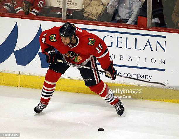 Fernando Pisani of the Chicago Blackhawks shoots the puck against the Florida Panthers at the United Center on March 23 2011 in Chicago Illinois The...