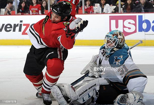 Fernando Pisani of the Chicago Blackhawks skates in front of San Jose Sharks' goalie Antti Niemi on March 14 2011 at the United Center in Chicago...