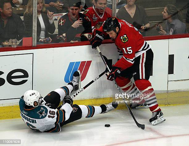 Fernando Pisani of the Chicago Blackhawks tries to control the puck after Devin Setoguchi of the San Jose Sharks falls to the ice at the United...