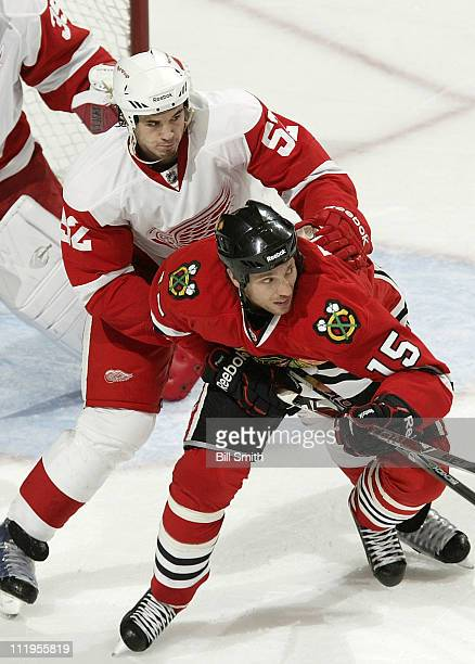 Fernando Pisani of the Chicago Blackhawks waits for the puck as Jonathan Ericsson of the Detroit Red Wings stands behind on April 10 2011 at the...
