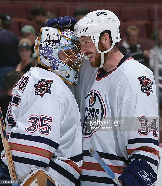 Fernando Pisani of the Edmonton Oilers congratulates teammate goaltender Dwayne Roloson on their win over the Mighty Ducks of Anaheim in game two of...