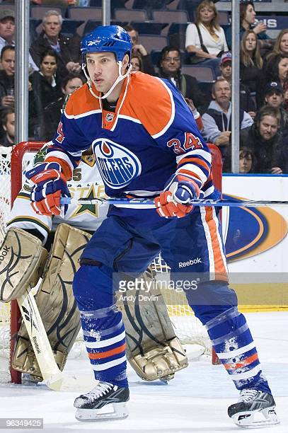 Fernando Pisani of the Edmonton Oilers sets up in front of Marty Turco of the Dallas Stars at Rexall Place on January 22 2010 in Edmonton Alberta...