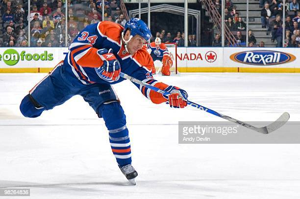 Fernando Pisani of the Edmonton Oilers takes a shot on goal against the Anaheim Ducks at Rexall Place on March 26 2010 in Edmonton Alberta Canada
