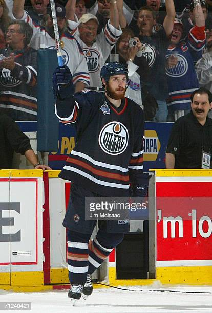 Fernando Pisani of the Edmonton Oilers waves to the crowd after defeating the Carolina Hurricanes in game six of the 2006 NHL Stanley Cup Finals on...
