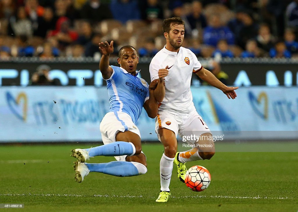http://media.gettyimages.com/photos/fernando-reges-of-manchester-city-and-miralem-pjanic-of-as-roma-the-picture-id481468318