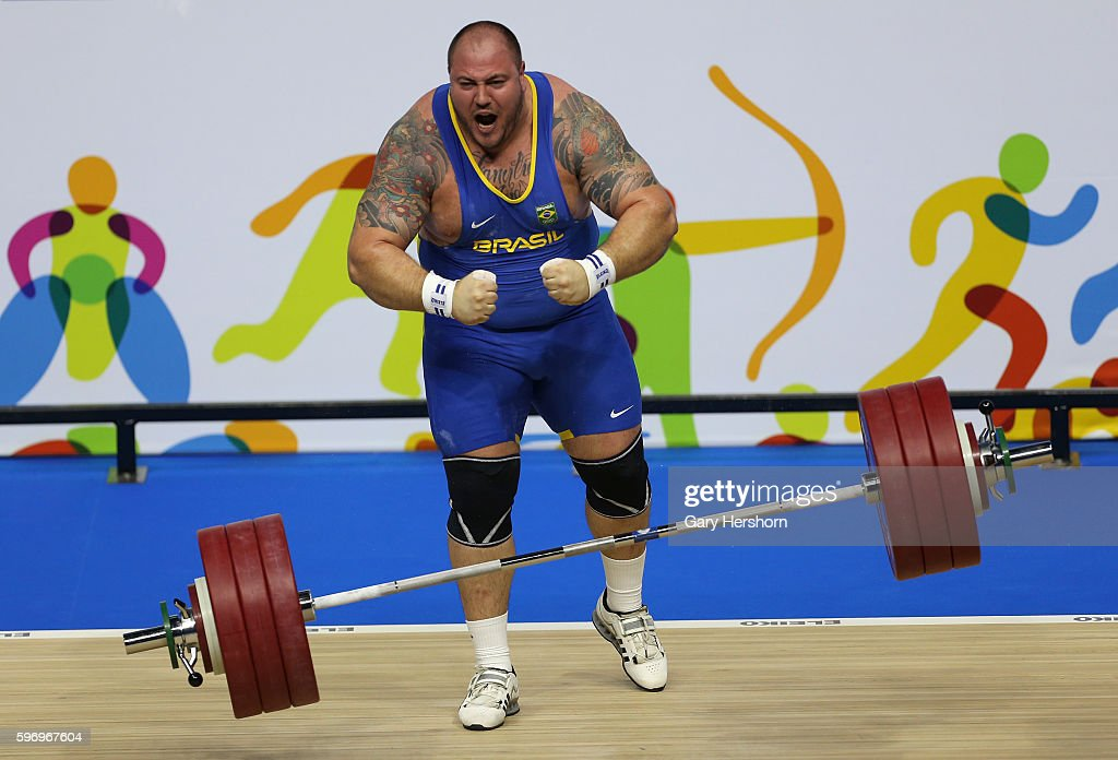 Fernando Reis of Brazil celebrates successfully lifting 192kg in the snatch competiton of the 105kg group in weightlifting at the Toronto 2015 PanAm...
