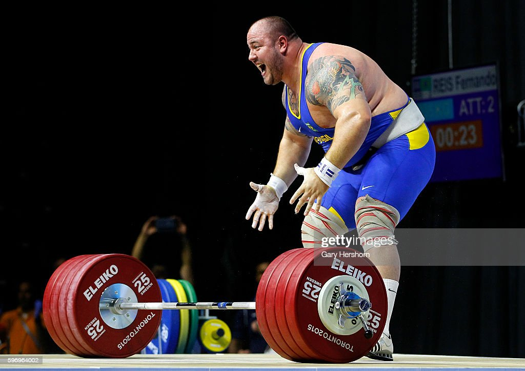 Fernando Reis of Brazil celebrates successfully lifting 235kg in the clean and jerk competiton of the 105kg group in weightlifting at the Toronto...