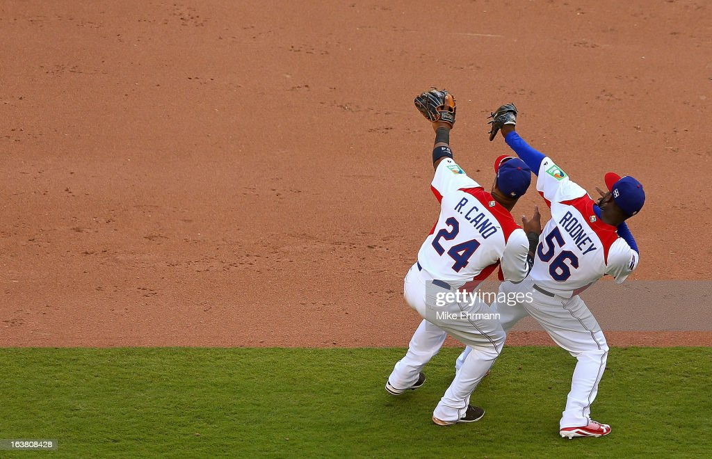 Fernando Rodney #56 and Robinson Cano #24 of the Dominican Republic celebrate after winning a World Baseball Classic second round game against Puerto Rico at Marlins Park on March 16, 2013 in Miami, Florida.