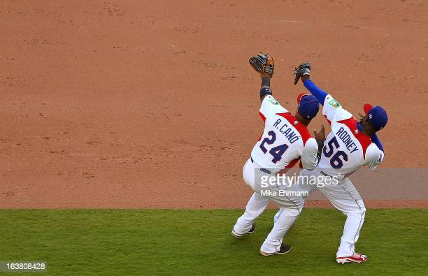 Fernando Rodney and Robinson Cano of the Dominican Republic celebrate after winning a World Baseball Classic second round game against Puerto Rico at...
