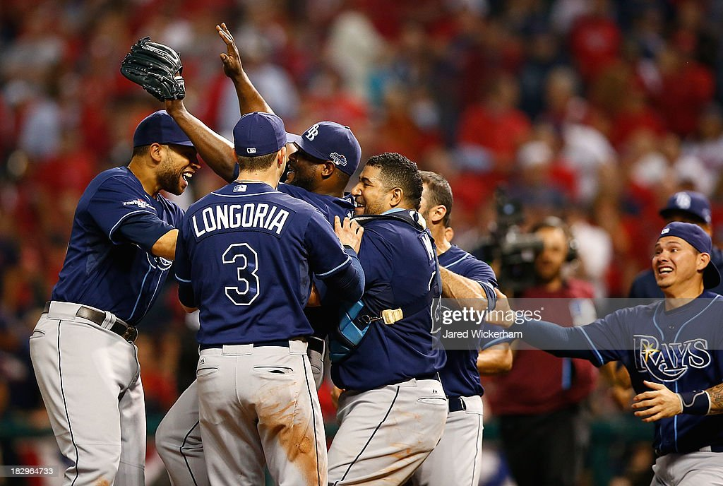 Fernando Rodney #56, Evan Longoria #3, and Jose Molina #28 of the Tampa Bay Rays celebrate after defeating the Cleveland Indians 4-0 in the American League Wild Card game at Progressive Field on October 2, 2013 in Cleveland, Ohio.