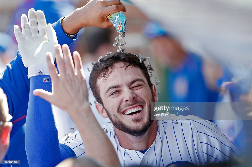 Fernando Rodney #57 of the Chicago Cubs (not pictured) pours sunflower seeds onto Kris Bryant #17 after he hit a home run against the St Louis Cardinals during the fifth inning at Wrigley Field on September 19, 2015 in Chicago, Illinois.