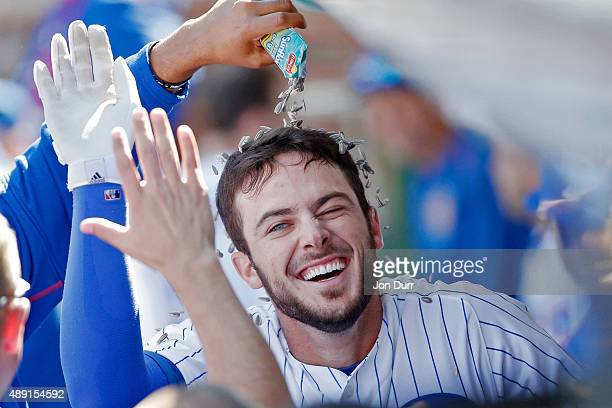 Fernando Rodney of the Chicago Cubs pours sunflower seeds onto Kris Bryant after he hit a home run against the St Louis Cardinals during the fifth...