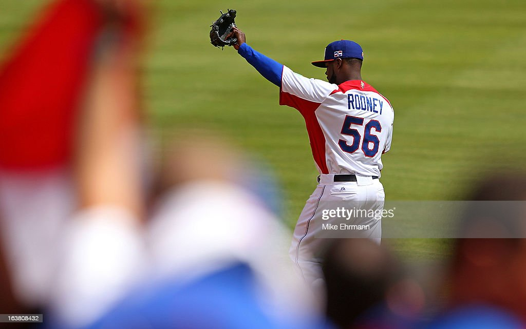 <a gi-track='captionPersonalityLinkClicked' href=/galleries/search?phrase=Fernando+Rodney&family=editorial&specificpeople=547291 ng-click='$event.stopPropagation()'>Fernando Rodney</a> #56 of the Dominican Republic greets the crowd during a World Baseball Classic second round game against Puerto Rico at Marlins Park on March 16, 2013 in Miami, Florida.