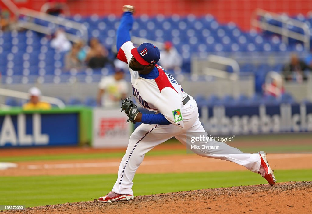<a gi-track='captionPersonalityLinkClicked' href=/galleries/search?phrase=Fernando+Rodney&family=editorial&specificpeople=547291 ng-click='$event.stopPropagation()'>Fernando Rodney</a> #56 of the Dominican Republic pitches during a World Baseball Classic second round game against Italy at Marlins Park on March 12, 2013 in Miami, Florida.