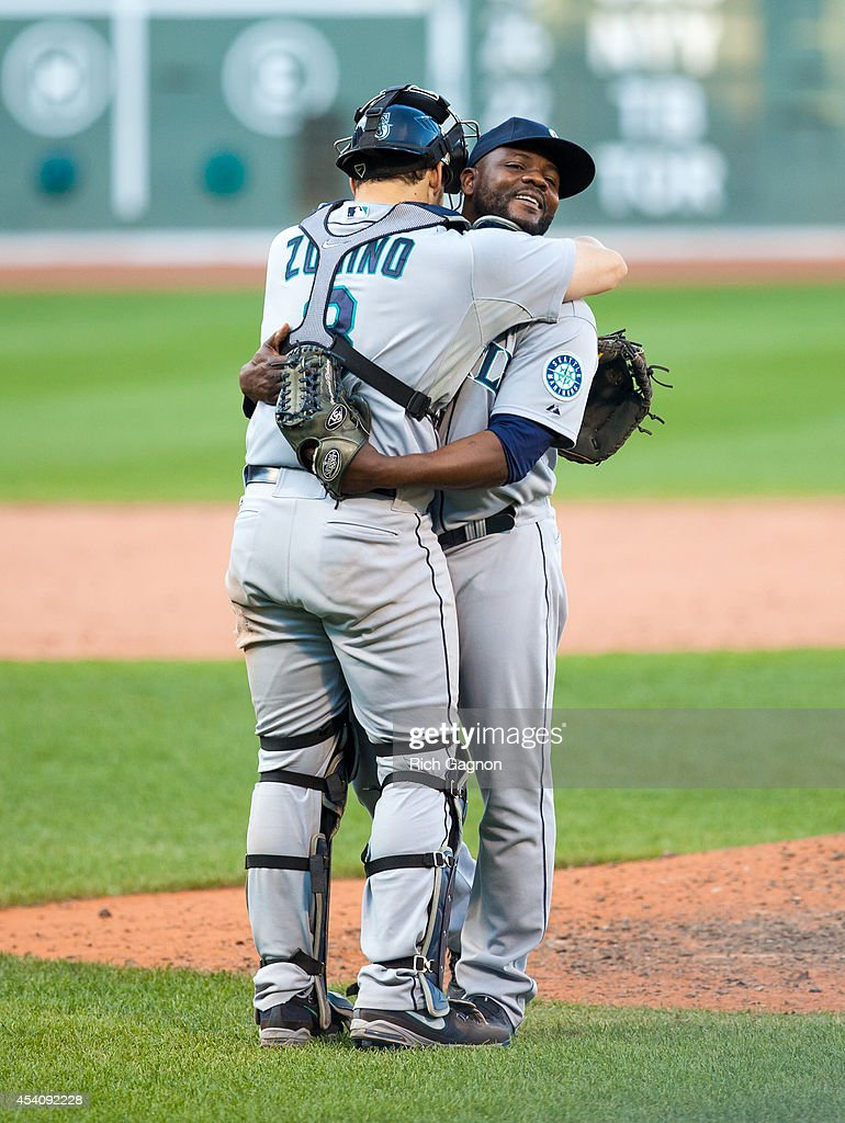 Fernando Rodney #56 of the Seattle Mariners celebrates a victory with teammate Mike Zunino #3 against the Boston Red Sox at Fenway Park on August 24, 2014 in Boston, Massachusetts. The Mariners won 8-6.