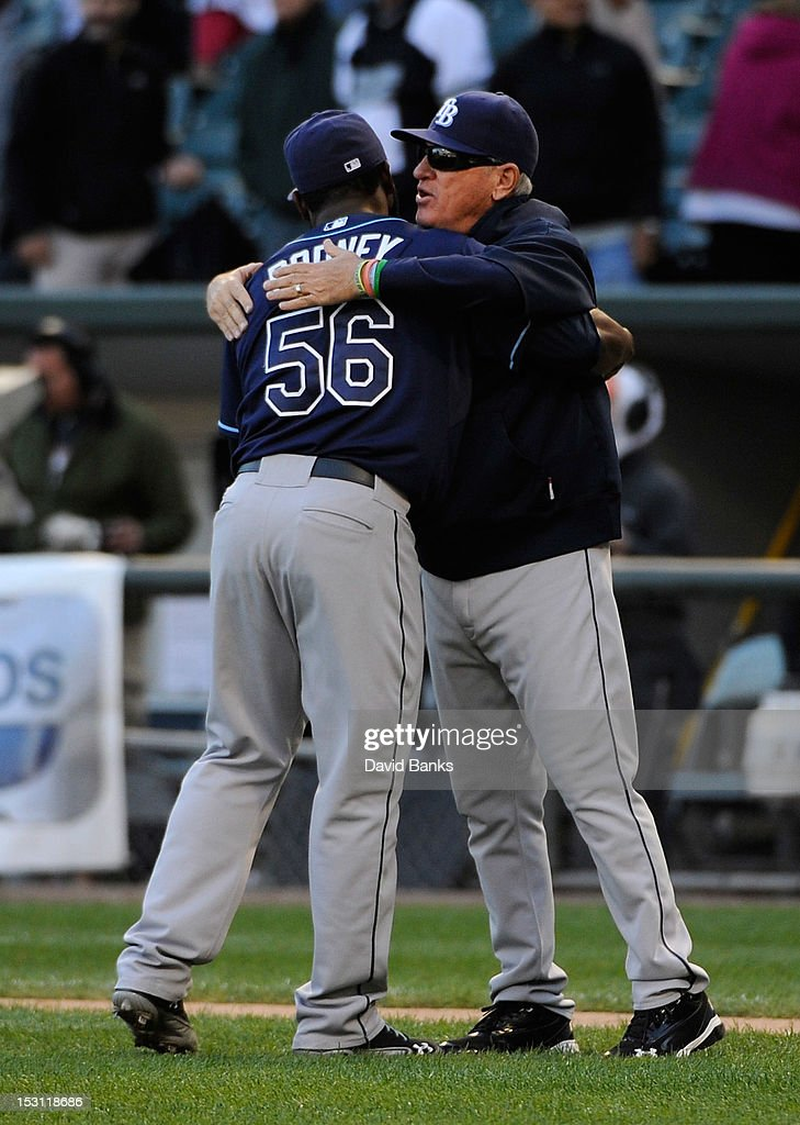 <a gi-track='captionPersonalityLinkClicked' href=/galleries/search?phrase=Fernando+Rodney&family=editorial&specificpeople=547291 ng-click='$event.stopPropagation()'>Fernando Rodney</a> #56 of the Tampa Bay Rays gets a hug from manager <a gi-track='captionPersonalityLinkClicked' href=/galleries/search?phrase=Joe+Maddon&family=editorial&specificpeople=568433 ng-click='$event.stopPropagation()'>Joe Maddon</a> #70 after their win against the Chicago White Sox on September 30, 2012 at U.S. Cellular Field in Chicago, Illinois. The Tampa Bay Rays defeated the Chicago White Sox 6-2.