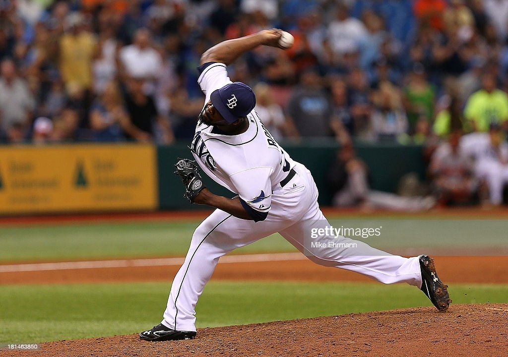 <a gi-track='captionPersonalityLinkClicked' href=/galleries/search?phrase=Fernando+Rodney&family=editorial&specificpeople=547291 ng-click='$event.stopPropagation()'>Fernando Rodney</a> #56 of the Tampa Bay Rays pitches during a game against the Baltimore Orioles at Tropicana Field on September 21, 2013 in St Petersburg, Florida.